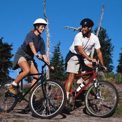 Couple Riding Mountain Bikes