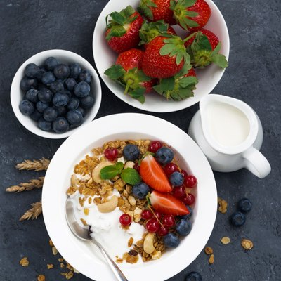 baked muesli with fresh berries and yogurt for breakfast
