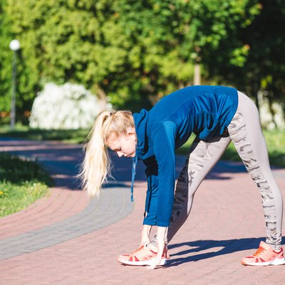 Fitness woman doing exercises during outdoor cross training workout in