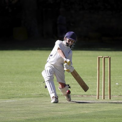 Young boy playing cricket shot