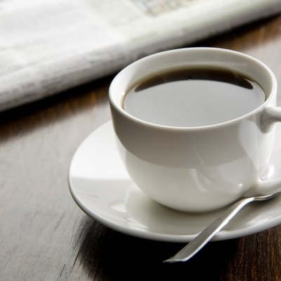 Black coffee and a paper