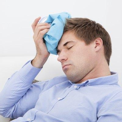 Man Suffering With Headache