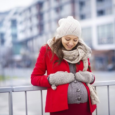 Winter portrait of beautiful pregnant woman