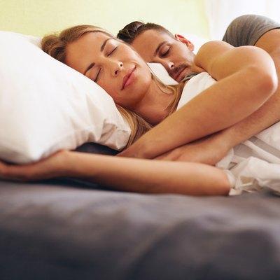 Young couple sleeping embraced