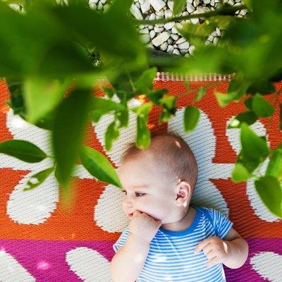 Baby Boy is Lying Down in the Backyard