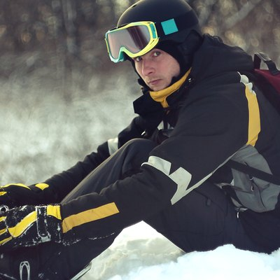 Man gets snowboard and looks at the camera