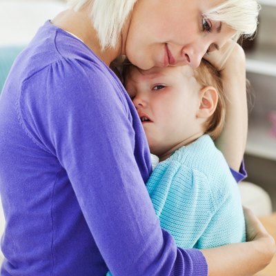Blond woman taking care of her child