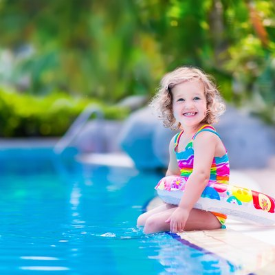 Sweet little girl in swimming pool