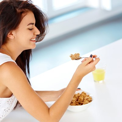 Woman with a spoon and a bowl of cereal