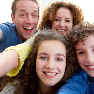Happy family with teenage children.