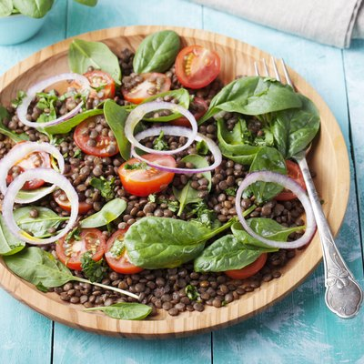 Lentil salad with cherry tomatoes, red onion and baby spinach.