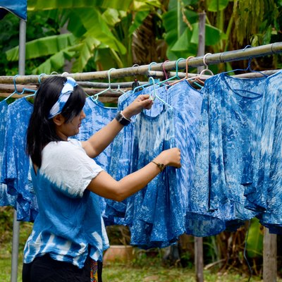 People working Batik dye Mauhom color