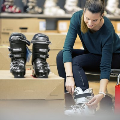 young woman shopping for ski boots