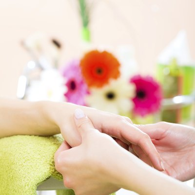 Woman in nail salon receiving hand massage