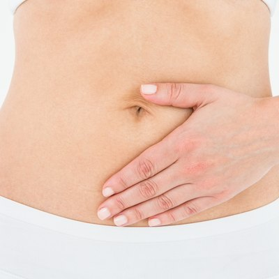 Fit woman touching her painful stomach
