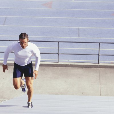Man running up steps at sports stadium, elevated view