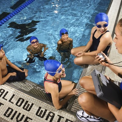 Swimming coach with team