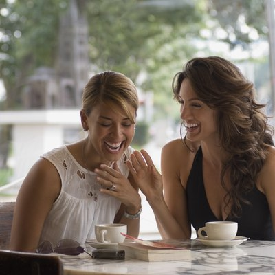 Laughing women in cafe