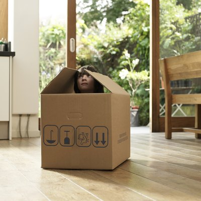Child in cardboard box
