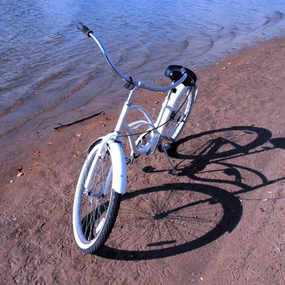 white retro bike on a sand beach