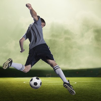 Soccer player kicking the ball in a stadium, green sky with clouds