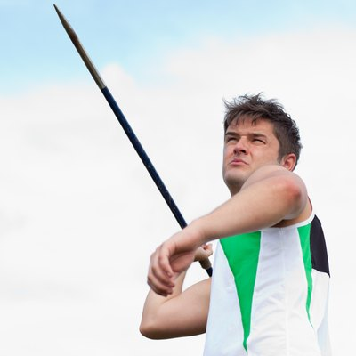 Determined sportsman throwing the javelin