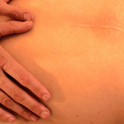 Massaging Scarred Back