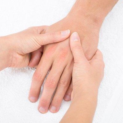 Physiotherapist Massaging Palm