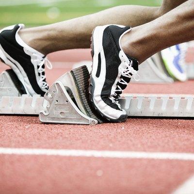 Feet of runners on starting blocks