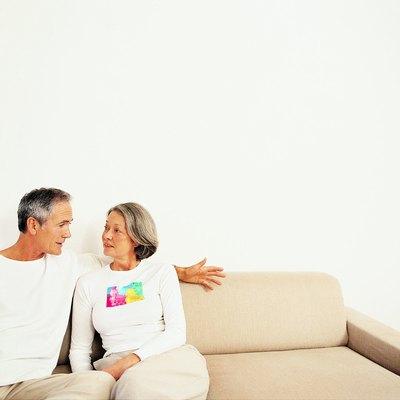 Mature Couple Talking on a Sofa