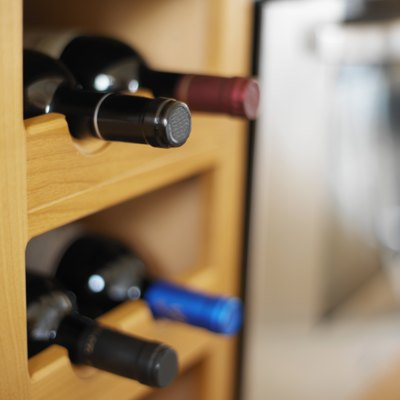 close-up of wine bottles on shelves