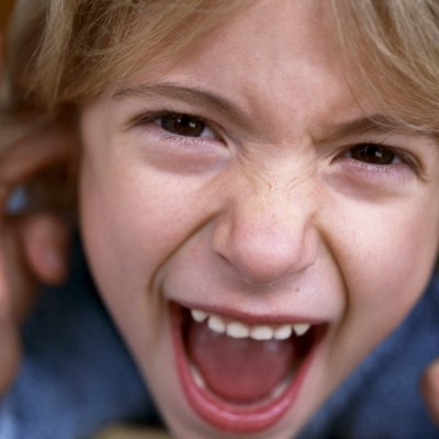 A headshot of a child screaming