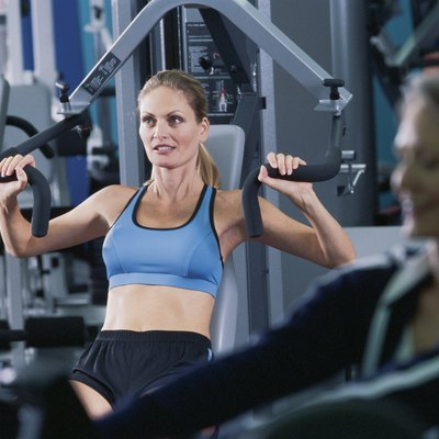 Woman on exercise machine