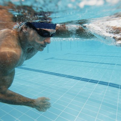 Underwater Shot of a Young Man Swimming in a Pool