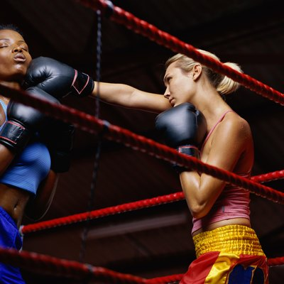 Low angle view of two female boxers fighting in a ring