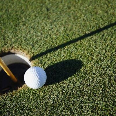 Golf ball close to pin