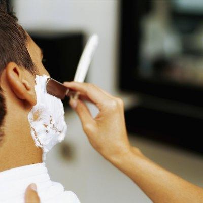 barber shaving a man