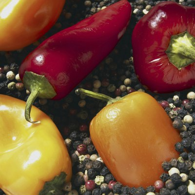 Assorted chili peppers on peppercorns