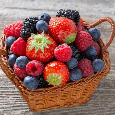 basket with fresh seasonal berries, top view