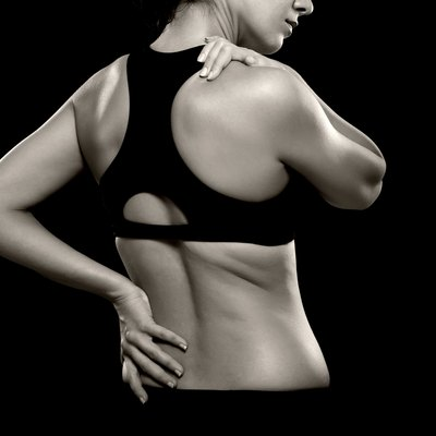 Woman with Lower Back and Shoulder Pain