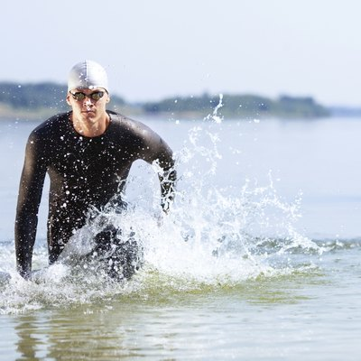 Triathlete running out of the water