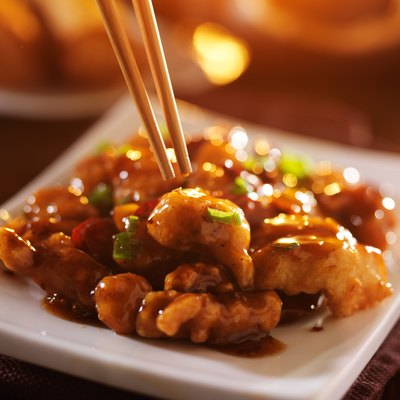 eating chinese food general tso's chicken