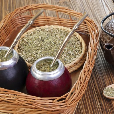 Yerba  and mate in calabash on a wicker tray