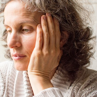 Middle aged woman looking pensive
