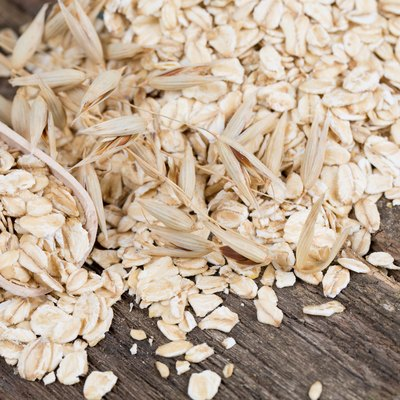 oat flakes in a spoon on wooden surface