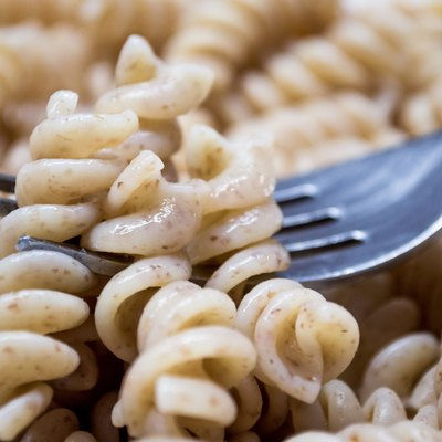 Cooked Plain Brown Wholewheat Fusilli Pasta on a Fork