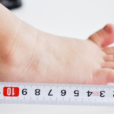measuring feet to a baby