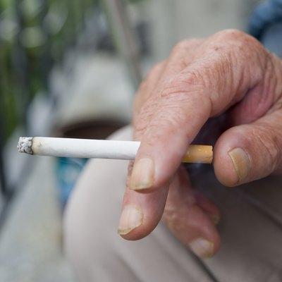 Holding Burning Cigarette