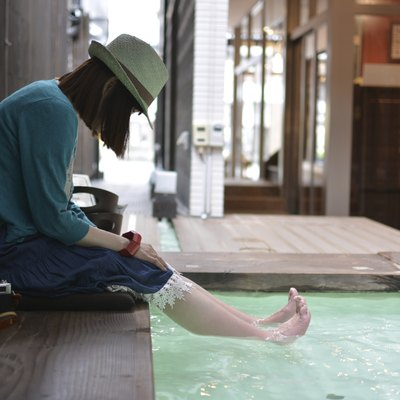 Relax woman looking at barefoot in the foot bath.