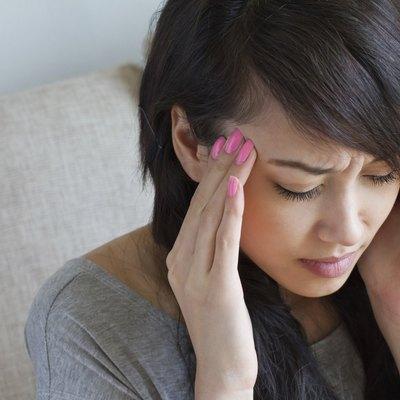 woman with headache, migraine, stress, insomnia, hangover, asian